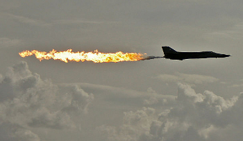 F111, flaming from the rear, as it performs a 'dump and burn'.